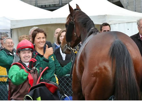 Jockey Dean Yendall, strapper Sarah Woodhouse and a shy Turnitaround in the winner's stall at Warrnambool.